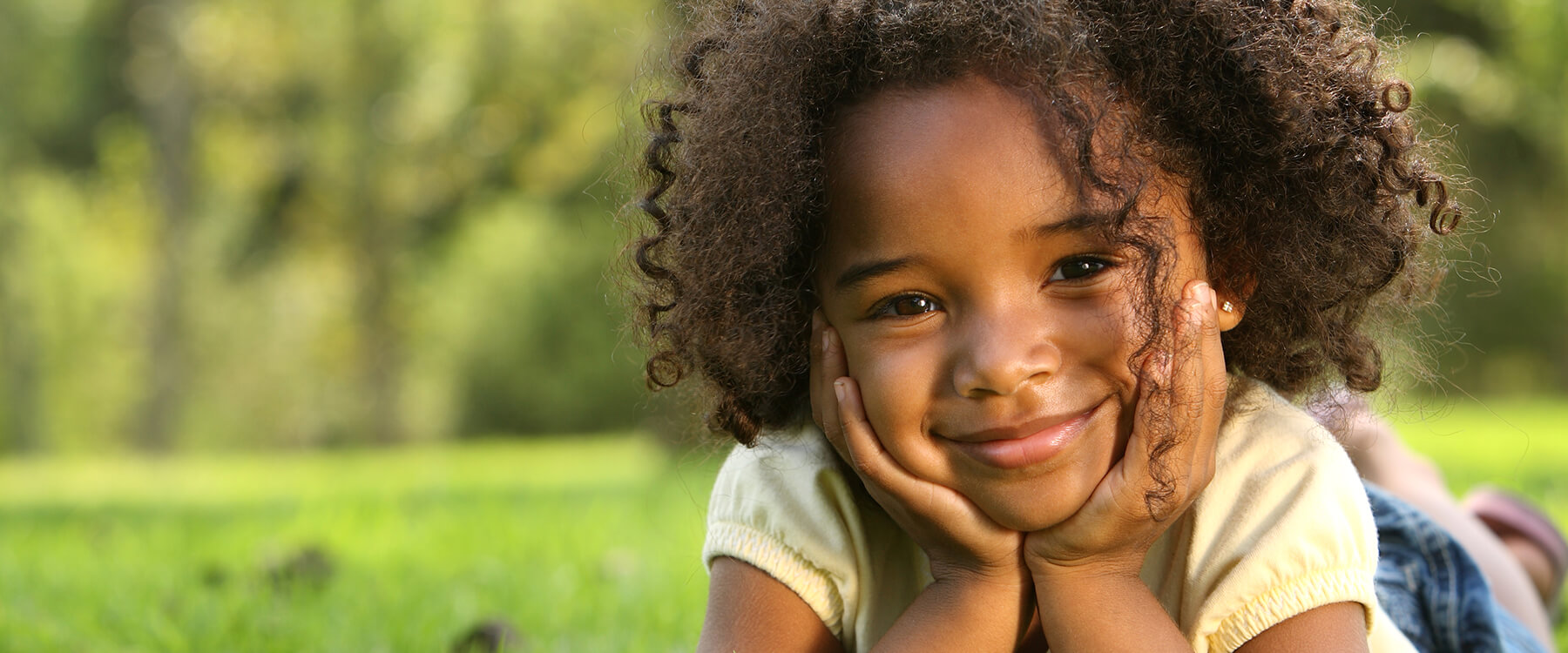 Black Girl in the Grass - Pediatric Dentistry in Gallatin, TN